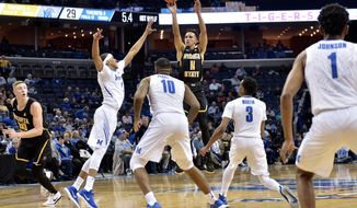 Wichita State guard Landry Shamet (11) shoots against Memphis forward Jimario Rivers, left, forward Mike Parks Jr. (10), and guard Jeremiah Martin (3) during the first half of an NCAA college basketball game Tuesday, Feb. 6, 2018, in Memphis, Tenn. (AP Photo/Brandon Dill)