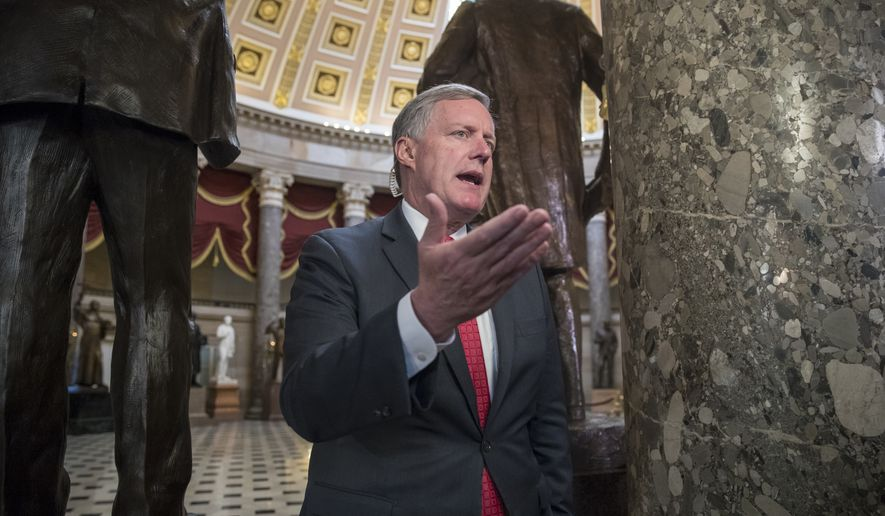 Rep. Mark Meadows, R-N.C., chairman of the conservative Freedom Caucus, speaks during a television news interview just before passage of the Republican tax reform bill in the House of Representatives, on Capitol Hill, in Washington, Tuesday, Dec. 19, 2017. (AP Photo/J. Scott Applewhite)