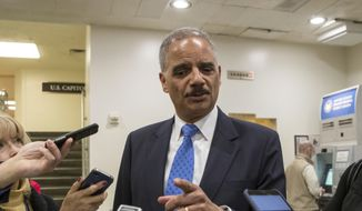 Former Attorney General Eric Holder takes questions from reporters at the Capitol where he attended the swearing-in of Sen. Doug Jones, D-Ala., in Washington, Wednesday, Jan. 3, 2018. (AP Photo/J. Scott Applewhite) ** FILE **