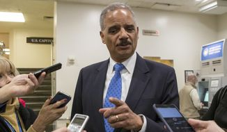 """Former Attorney General Eric Holder takes questions from reporters at the Capitol where he attended the swearing-in of Sen. Doug Jones, D-Ala., in Washington, Wednesday, Jan. 3, 2018. Holder says he is """"deeply disturbed"""" that Attorney General Jeff Sessions hasn't spoken out to defend his employees at the Justice Department amid Republican criticism of the FBI. (AP Photo/J. Scott Applewhite)"""