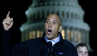 Sen. Cory Booker D-N.J., speaks during a rally in support of the Deferred Action for Childhood Arrivals (DACA), and to avoid the government shut down on Capitol Hill, Friday, Jan. 19, 2018, in Washington. (AP Photo/Jose Luis Magana) ** FILE **