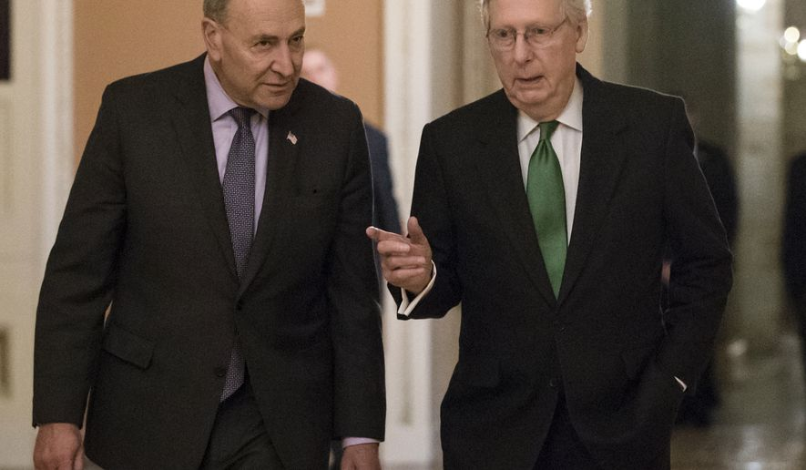 Senate Minority Leader Chuck Schumer, D-N.Y., left, and Senate Majority Leader Mitch McConnell, R-Ky., walk to the chamber after collaborating on an agreement in the Senate on a two-year, almost $400 billion budget deal that would provide Pentagon and domestic programs with huge spending increases, at the Capitol in Washington, Wednesday, Feb. 7, 2018. (AP Photo/J. Scott Applewhite)