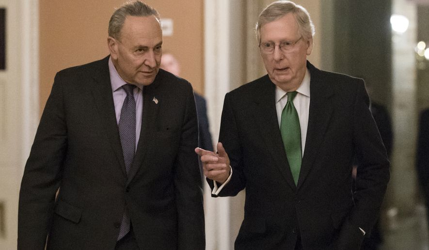 Senate Minority Leader Chuck Schumer, D-N.Y., left, and Senate Majority Leader Mitch McConnell, R-Ky., walk to the chamber after collaborating on an agreement in the Senate on a two-year, almost $400 billion budget deal that would provide Pentagon and domestic programs with huge spending increases, at the Capitol in Washington, Wednesday, Feb. 7, 2018. (AP Photo/J. Scott Applewhite) **FILE**