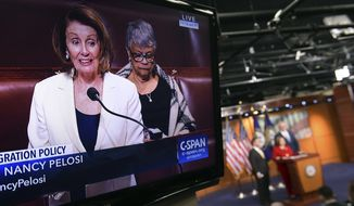 House Minority Leader Nancy Pelosi of Calif., is shown on television as she speaks from the House floor on Capitol Hill in Washington, Wednesday, Feb. 7, 2018, as a news conference that she was supposed to attend goes on in the background. (AP Photo/Susan Walsh)