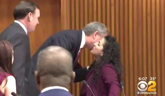 New York City Mayor Bill de Blasio greets a female lawmaker with a kiss. (Image: CBS-2 New York)