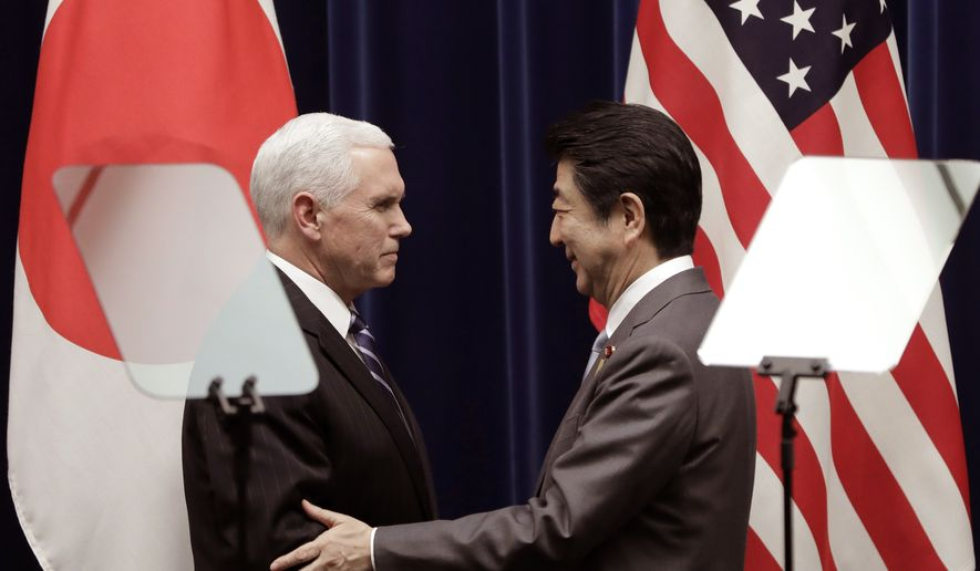 U.S. Vice President Mike Pence, left, shakes hands with Japan's Prime Minister Shinzo Abe during a joint news conference at Abe's official residence in Tokyo Wednesday, Feb. 7, 2018. (Kiyoshi Ota/Pool Photo via AP)