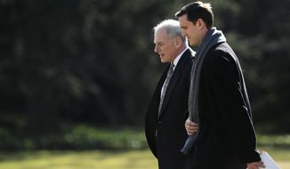 White House staff secretary Rob Porter, front, walks with White House Chief of Staff John Kelly, to board the Marine One on the South Lawn as they leave the White House in Washington, Friday, Feb. 2, 2018, with President Donald Trump en route to the Customs and Border Protection National Targeting Center in Sterling, Va. (AP Photo/Manuel Balce Ceneta)