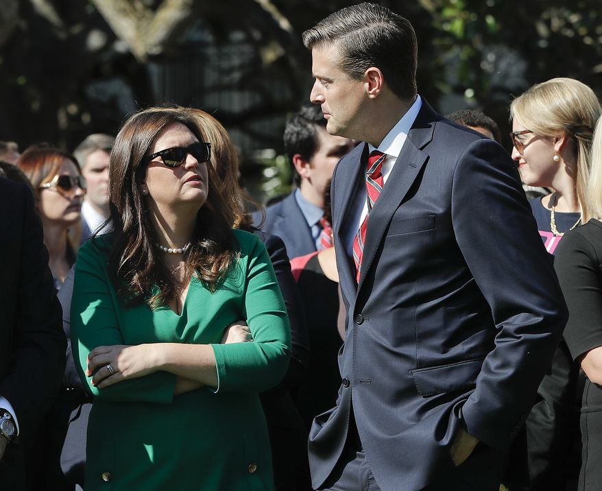 White House Staff Secretary Rob Porter, right, talks with White House press secretary Sarah Huckabee Sanders, left, as they wait for the arrival of President Donald Trump and begin a moment of silence to remember the victims of the mass shooting in Las Vegas, on the South Lawn of the White House in Washington, Monday, Oct. 2, 2017. (AP Photo/Pablo Martinez Monsivais) **FILE**