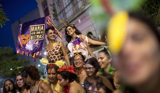 "In this Feb. 3, 2018 photo, women take part in the block party ""Maria vem com as outras,"" or ""Maria, join the other women,"" in Rio de Janeiro, Brazil. Many women in Latin America's largest nation are doing exactly that during this year's Carnival celebrations, with block parties of all-female musicians, popular accessories with messages like ""my breasts, my rules"" and several campaigns to report and crackdown on harassment. (AP Photo/Silvia Izquierdo)"