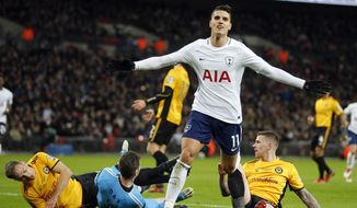 Tottenham's Erik Lamela celebrates after scoring his side's second goal during the English FA Cup fourth round replay soccer match between Tottenham Hotspur and Newport County at Wembley Stadium in London, Wednesday, Feb. 7, 2018.(AP Photo/Frank Augstein)