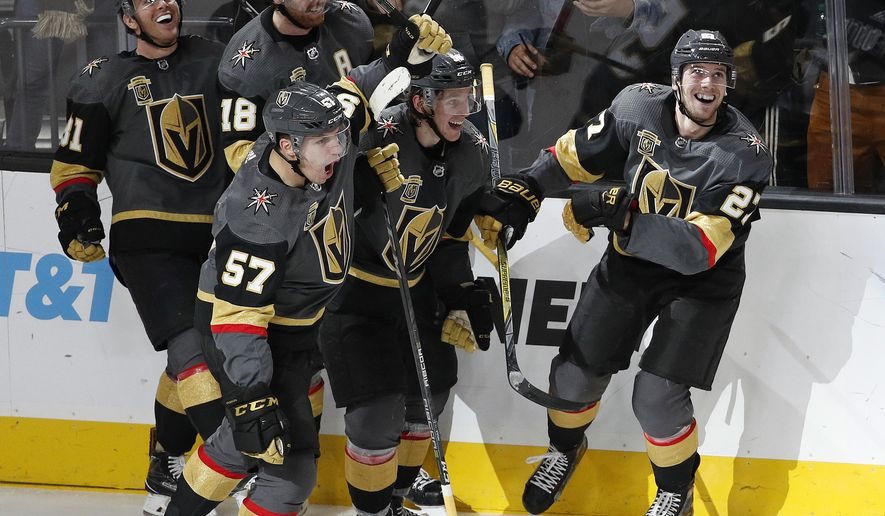 FILE - In this Dec. 19, 2017, file photo, Vegas Golden Knights celebrate after defenseman Shea Theodore, right, scored the game-winning goal against the Tampa Bay Lightning during the third period of an NHL hockey game in Las Vegas. The Golden Knights won, 4-3. The NHL wanted the Vegas Golden Knights to be competitive, but no one expected them to turn up this kind of magic on and off the Las Vegas Strip. Vegas is already the most successful first-year expansion franchise in league history and looks like a serious Stanley Cup contender. (AP Photo/John Locher, File)