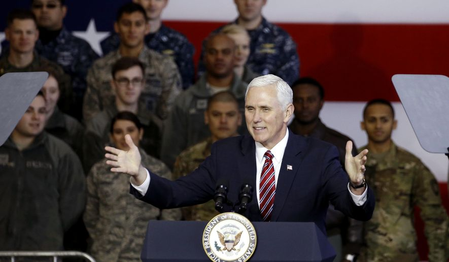 U.S. Vice President Mike Pence addresses members of U.S. military services and Japan Self-Defense Force before he departs for South Korea, at U.S. Air Force Yokota base in Fussa, on the outskirts of Tokyo, Japan, Thursday, Feb. 8, 2018. (Toru Hanai/Pool Photo via AP)