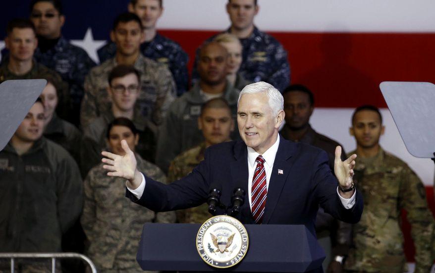 U.S. Vice President Mike Pence addresses members of U.S. military services and Japan Self-Defense Force before he departs for South Korea, at U.S. Air Force Yokota base in Fussa, on the outskirts of Tokyo, Japan, Thursday, Feb. 8, 2018. (Toru Hanai/Pool Photo via AP)