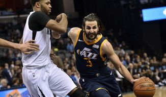 Utah Jazz guard Ricky Rubio (3) drives against Memphis Grizzlies guard Andrew Harrison during the second half of an NBA basketball game Wednesday, Feb. 7, 2018, in Memphis, Tenn. (AP Photo/Brandon Dill)