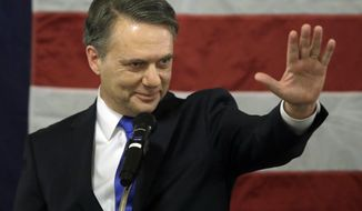 FILE - In this Wednesday, Jan. 31, 2018, file photo, Gov. Jeff Colyer waves after being sworn in as the 47th governor of Kansas during a ceremony at the Statehouse in Topeka, Kan. Colyer is expected to outline proposals for making state government more transparent during an address to the Legislature, on Wednesday, Feb. 7. (AP Photo/Orlin Wagner, File)