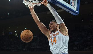 FILE - In this Nov. 11, 2017, file photo, New York Knicks' Willy Hernangomez dunks against the Sacramento Kings during the second half of a NBA basketball game at Madison Square Garden in New York. A person with knowledge of the deal says the Knicks have agreed to trade center Hernangomez to the Charlotte Hornets. The person says the Knicks will receive a pair of second-round picks and Johnny O'Bryant in the deal that was agreed to Wednesday, Feb. 7, 2018, the day before the NBA trade deadline. The person spoke with The Associated Press on condition of anonymity because the trade is not yet official.(AP Photo/Andres Kudacki, File)
