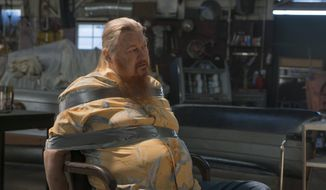 "This image released by FX shows Mickey Jones as Rodney ""Hot Rod"" Dunham in a scene from ""Justified."" Jones, 76, a native of Houston, Texas, native, who worked steadily in TV and film since the 1970s, died early Wednesday of the effects of a long illness. The illness was not disclosed. (Prashant Gupta/FX via AP)"