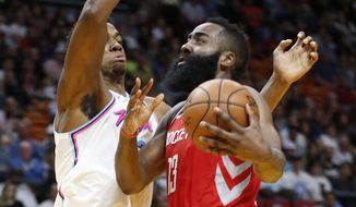 Houston Rockets guard James Harden (13) goes up for a shot against Miami Heat center Hassan Whiteside (21) during the first half of an NBA basketball game, Wednesday, Feb. 7, 2018, in Miami. (AP Photo/Wilfredo Lee)