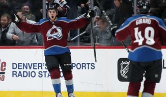 Colorado Avalanche center Tyson Jost, back, celebrates after scoring a goal with defenseman Samuel Girard against the San Jose Sharks in the second period of an NHL hockey game Tuesday, Feb. 6, 2018, in Denver. (AP Photo/David Zalubowski)