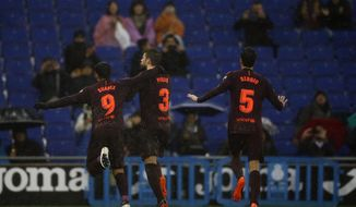 FC Barcelona's Gerard Pique, center, celebrates after scoring during the Spanish La Liga soccer match between Espanyol and FC Barcelona at RCDE stadium in Cornella Llobregat, Spain, Sunday, Feb. 4, 2018. (AP Photo/Manu Fernandez)