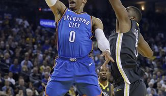 Oklahoma City Thunder guard Russell Westbrook (0) drives past Golden State Warriors' Kevon Looney during the first half of an NBA basketball game Tuesday, Feb. 6, 2018, in Oakland, Calif. (AP Photo/Marcio Jose Sanchez)