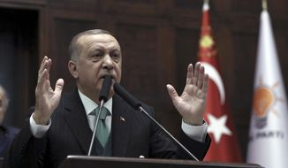 Turkey's President and leader of Justice and Development Party Recep Tayyip Erdogan addresses the members of his ruling party at the parliament in Ankara, Turkey, Tuesday, Feb. 6, 2018.(AP Photo/Burhan Ozbilici)