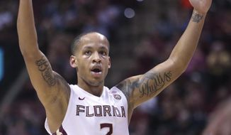 Florida State's CJ Walker celebrates making a three point shot against Virginia in the first half of an NCAA college basketball game, Wednesday, Feb. 7, 2018, in Tallahassee, Fla. Virginia won 59-55. (AP Photo/Steve Cannon)