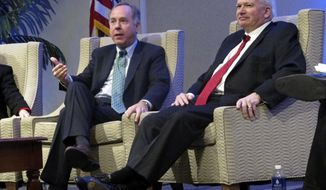Wisconsin Assembly Speaker Robin Vos, left, and Senate Majority Leader Scott Fitzgerald voice their support for interstate tolling in Wisconsin at a meeting of the Wisconsin Counties Association on Wednesday, Feb. 7, 2018, in Madison, Wis. (AP Photo/Scott Bauer).