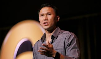 """""""I tell jokes about getting shot in the head,"""" said Thom Tran, a stand-up comic/musician who credits his new career with his successful transition to civilian life. He plans to do his part in helping other combat veterans by participating this month in GallantFew's Run Ranger Run event. (Associated Press/File)"""