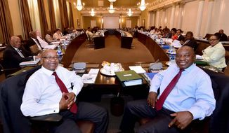 South African President Jacob Zuma (left) clings to power with former ally and designated heir apparent Cyril Ramaphosa waiting in the wings to take over the troubled African National Congress. Mr. Ramaphosa won election in ANC to cause the power struggle. (ASSOCIATED PRESS)