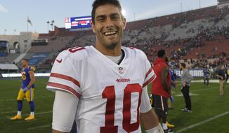 FILE - In this Dec. 31, 2017, file photo, San Francisco 49ers quarterback Jimmy Garoppolo smiles as he walks off the field after the team's 34-13 win over the Los Angeles Rams in an NFL football game in Los Angeles. Garoppolo has signed a five-year contract with the 49ers worth a reported record-breaking $137.5 million. Garoppolo reached the deal on Thursday, Feb. 8, 2018, allowing the Niners to lock up their franchise quarterback without using the franchise tag and before he could become a free agent next month. (AP Photo/Mark J. Terrill, File)