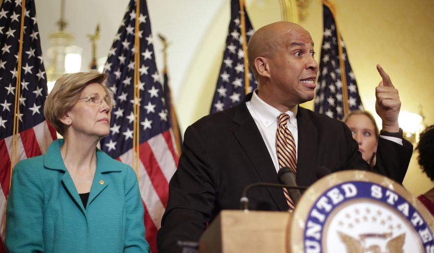 Sen. Cory Booker, D-N.J., and Sen. Elizabeth Warren, D-Mass., participate in a news conference on Capitol Hill in Washington, Tuesday, July 11, 2017, to discuss the introduction of the Dignity for Incarcerated Women Act. The bill helps address some of the unique challenges women face while in prison. (AP Photo/Pablo Martinez Monsivais) ** FILE **