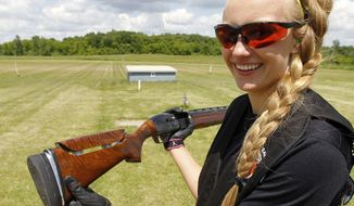 Kalley Johnson shows her Remington 1100 12-gauge shotgun as she finishes clay target practice at the Minneapolis Gun Club in Prior Lake, Minn., Thursday, June 18, 2015. Her father has modified the stock of the shotgun to fit her. Minnesota has a hot new high school sport: shooting. (AP Photo/Ann Heisenfelt)