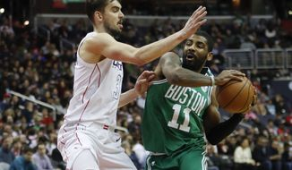 Boston Celtics guard Kyrie Irving (11) drives around Washington Wizards forward Tomas Satoransky (31), from the Czech Republic, during the second half of an NBA basketball game Thursday, Feb. 8, 2018, in Washington. (AP Photo/Pablo Martinez Monsivais)