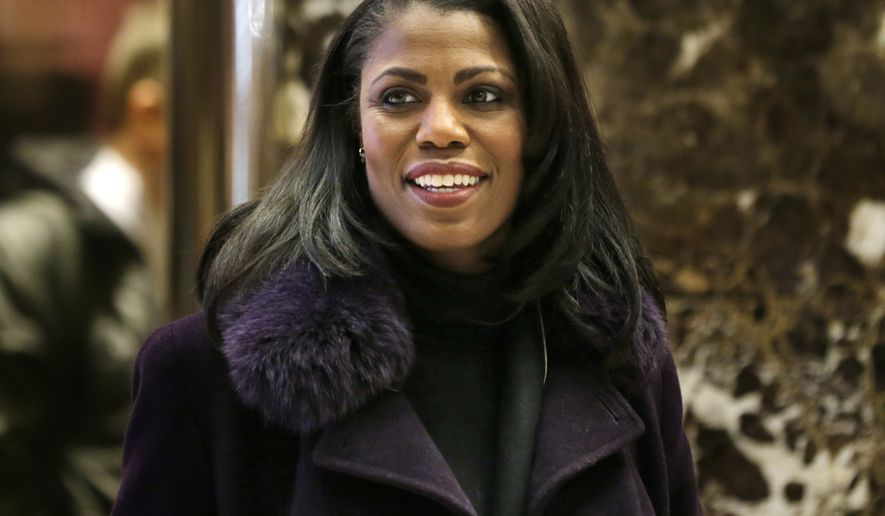 "FILE - In this Dec. 13, 2016 file photo, Omarosa Manigault smiles at reporters as she walks through the lobby of Trump Tower in New York. Manigault Newman is a cast member on ""Celebrity Big Brother,"" premiering Thursday on CBS.  (AP Photo/Seth Wenig)"