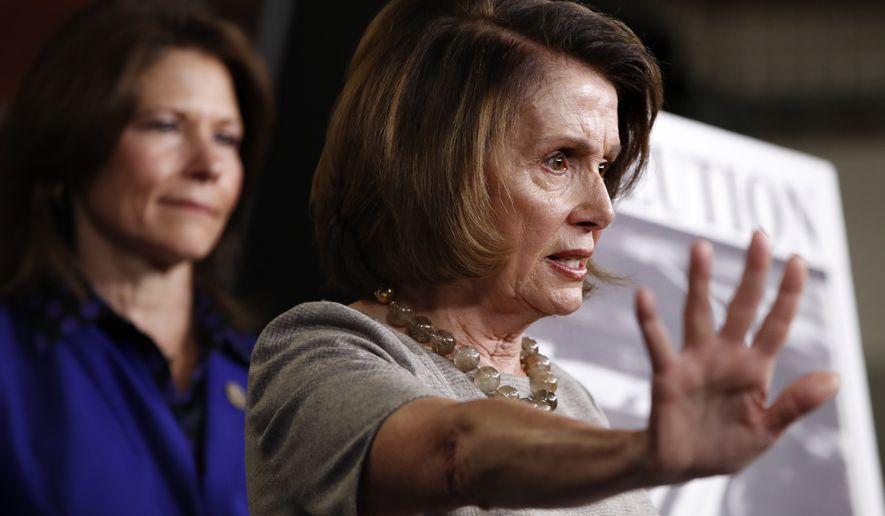 House Minority Leader Nancy Pelosi of Calif., right, speaks to the media, Thursday, Feb. 8, 2018, on Capitol Hill in Washington. At left is Rep. Cheri Bustos, D-Illinois. (AP Photo/Jacquelyn Martin)