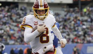 FILE - In this Dec. 31, 2017, file photo, Washington Redskins quarterback Kirk Cousins (8) rushes for a touchdown during the first half of an NFL football game against the New York Giants in East Rutherford, N.J. The quarterback carrousel began in the days before the Super Bowl when Kansas City agreed to trade Alex Smith to the Redskins. The deal, which cannot be finalized until March 14, spells the end of Cousins' time in Washington and hands the Chiefs' job to Patrick Mahomes III, the 10th pick in last year's draft out of Texas Tech. (AP Photo/Mark Lennihan, File)
