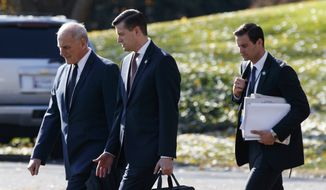 In this Nov. 29, 2017, file photo, White House Chief of Staff John Kelly, left, walks with White House staff secretary Rob Porter, center, and President Donald Trump's personal aide John McEntee to board Marine One on the South Lawn of the White House in Washington. (AP Photo/Evan Vucci) ** FILE **