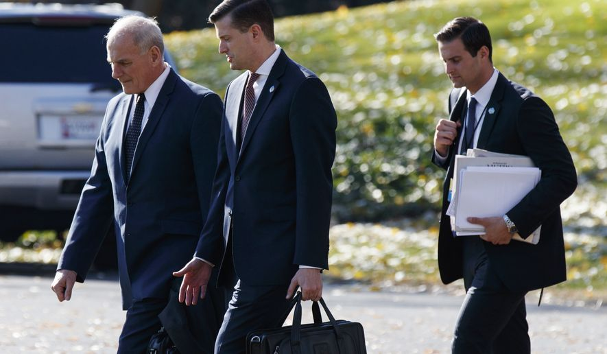 In this Nov. 29, 2017, file photo, White House Chief of Staff John Kelly, left, walks with White House staff secretary Rob Porter, center, and President Donald Trump's personal aide John McEntee to board Marine One on the South Lawn of the White House in Washington. (AP Photo/Evan Vucci)