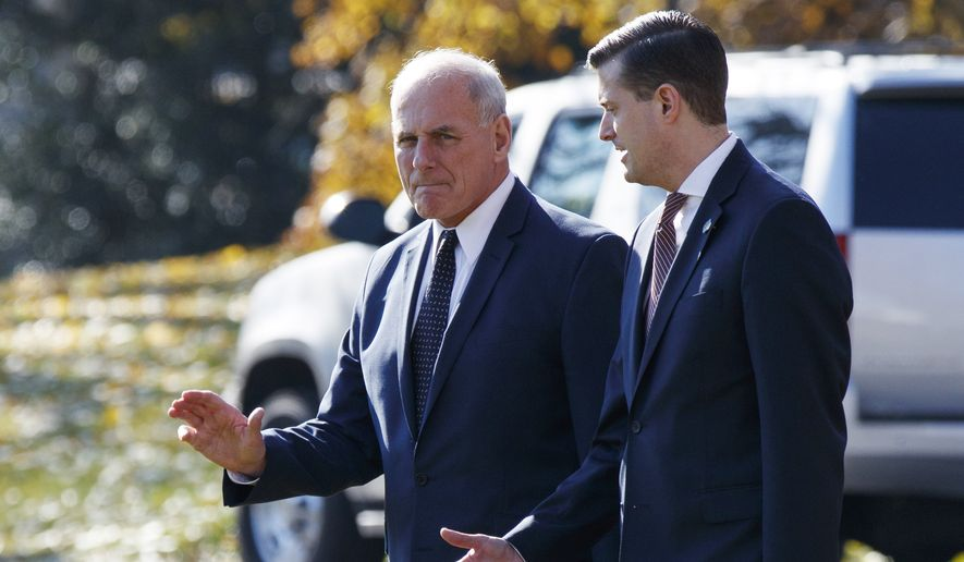 In this Nov. 29, 2017, file photo, White House Chief of Staff John Kelly, left, walks with White House staff secretary Rob Porter to board Marine One on the South Lawn of the White House in Washington. (AP Photo/Evan Vucci)