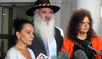 Australian indigenous opposition lawmakers Linda Burney, left, Pat Dodson, center, and Malarndirri McCarthy speak to reporters in Parliament House in Canberra, Australia Thursday, Feb. 8, 2018, after a report finds the life expectancy gap between Aboriginal and non-indigenous people is widening. Dodson accused the government of treating indigenous leaders with derision and contempt through a lack of consultation. (AP Photo/Rod McGuirk)