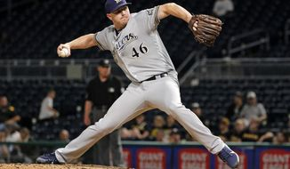 FILE - In this Sept. 19, 2017, file photo, Milwaukee Brewers relief pitcher Corey Knebel delivers in the ninth inning of the team's baseball game against the Pittsburgh Pirates in Pittsburgh. Knebel, Matt Albers and Josh Hader give the Brewers formidable relief options in the late innings.(AP Photo/Gene J. Puskar, File)