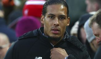 FILE - In this Sunday Jan. 14, 2018 file photo, Liverpool's Virgil van Dijk walks to the dugout prior to the English Premier League soccer match between Liverpool and Manchester City at Anfield Stadium, in Liverpool, England. Virgil van Dijk was widely trumpeted as the solution to Liverpool's defensive flimsiness when he joined for $100 million as the world's most expensive defender. Yet Liverpool hasn't kept a clean sheet in the four games Van Dijk has played in and only won one of them. (AP Photo/Dave Thompson, File)