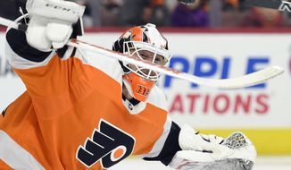 Philadelphia Flyers goalie Brian Elliott watches the puck after making a save against the Montreal Canadiens during the first period of an NHL hockey game Thursday, Feb. 8, 2018, in Philadelphia. (AP Photo/Derik Hamilton)
