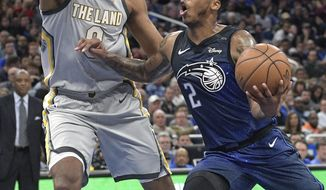 Orlando Magic guard Elfrid Payton (2) drives to the basket in front of Cleveland Cavaliers forward Channing Frye during the second half of an NBA basketball game Tuesday, Feb. 6, 2018, in Orlando, Fla. The Magic won 116-98. (AP Photo/Phelan M. Ebenhack)