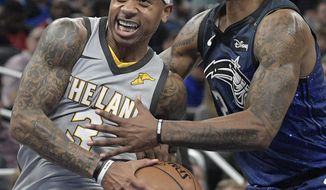 Cleveland Cavaliers guard Isaiah Thomas (3) drives to the basket in front of Orlando Magic guard Elfrid Payton (2), right, during the first half of NBA basketball game Tuesday, Feb. 6, 2018, in Orlando, Fla. (AP Photo/Phelan M. Ebenhack)