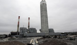 FILE - This Jan. 25, 2017 file photo shows Gallatin Fossil Plant in Gallatin, Tenn. Eighteen states, the U.S. Chamber of Commerce, national coal industry interests and more than a dozen other groups are urging an appeals court to overturn a coal ash cleanup order at a federal utility's Tennessee plant, contending the decision will have wide-reaching, expensive consequences. (AP Photo/Mark Humphrey, File)