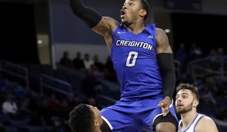 Creighton guard Marcus Foster, top, drives to the basket against DePaul guard Justin Roberts during the first half of an NCAA college basketball game Wednesday, Feb. 7, 2018, in Chicago. Creighton won 76-75. (AP Photo/Nam Y. Huh)