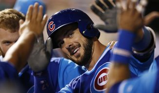 FILE - In this Aug. 26, 2017, file photo, Chicago Cubs' Kris Bryant is cheered in the dugout after hitting a home run in the fifth inning of a baseball game against the Philadelphia Phillies, in Philadelphia. Last season, Bryant batted .295 with 29 homers and 73 RBIs after winning the NL MVP award in 2016. (AP Photo/Laurence Kesterson, File)