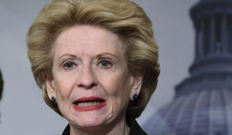 In this Feb. 7, 2018 photo, Sen. Debbie Stabenow, R-Mich., speaks during a news conference to announce a bipartisan resolution that would establish a special committee in the Senate to investigate the U.S. Olympic Committee and USA Gymnastics regarding how team doctor Larry Nassar was allowed to sexually abuse female gymnasts over decade.  (AP Photo/Susan Walsh)